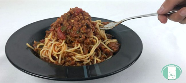 close up of best ever freezer meal spaghetti sauce on pasta