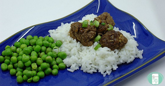 close up of easy Asian meatballs on rice with peas on the side