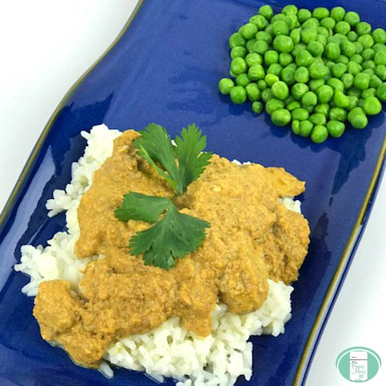 Chicken Tikka Masala cooked in the Instant Pot, served on rice with peas