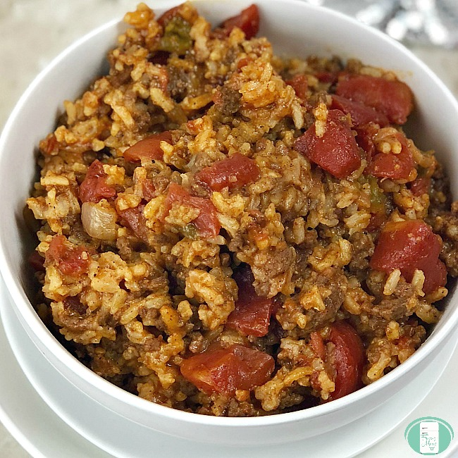 bowl of ground beef with rice and tomatoes