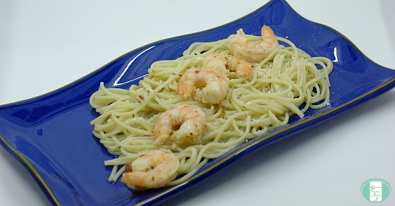 shrimp with garlic butter served on pasta