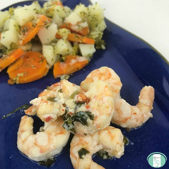 close up of tequila lime shrimp on a plate with vegetables