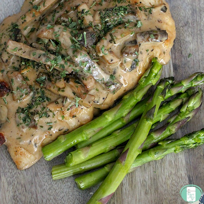 close up of easy chicken marsala with asparagus