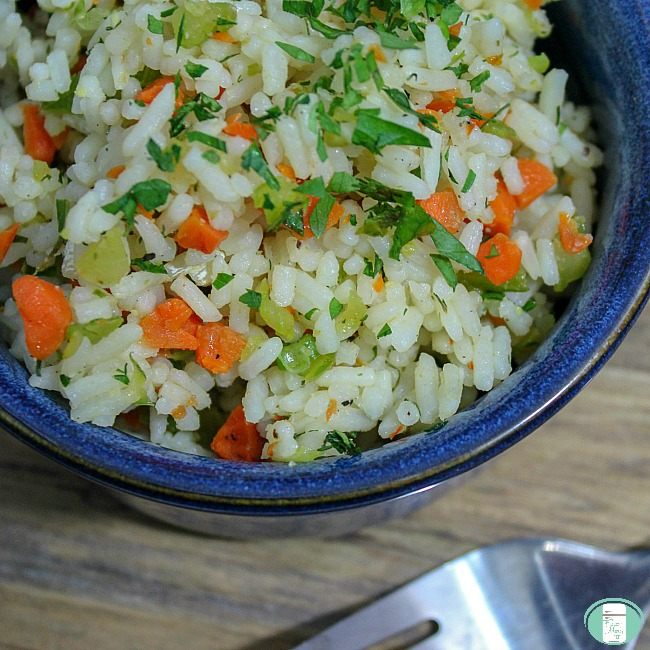 close up of rice pilaf in a blue bowl