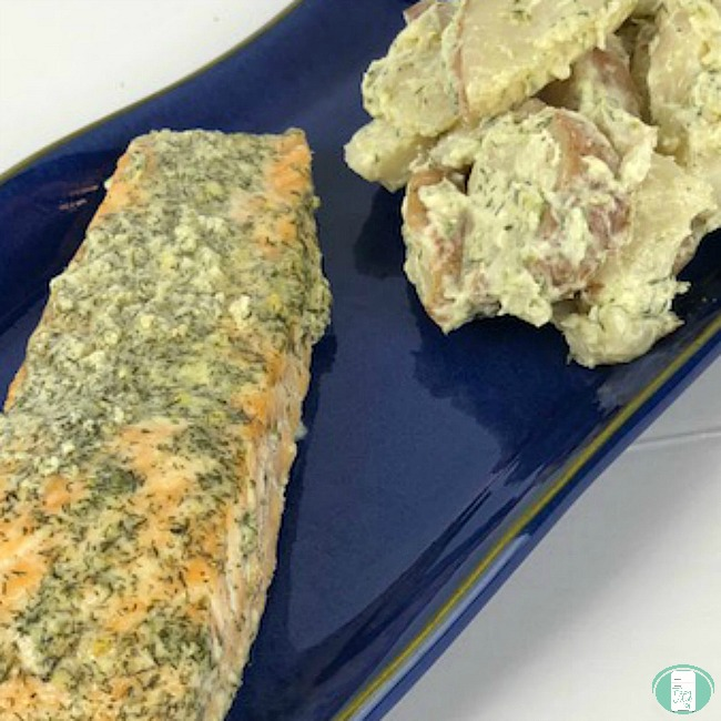 close up of maple dijon salmon with potato salad