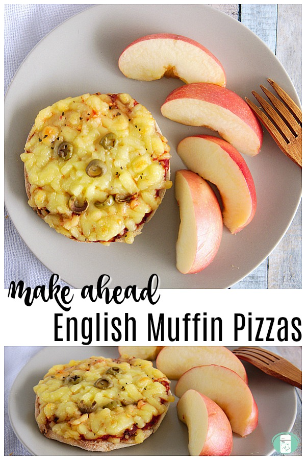 """a mini pizza with a smiley face made out of green olives sits beside apple slices on a white plate that has an oversized wooden fork resting on it with text that reads """"Make Ahead English Muffin Pizzas"""""""