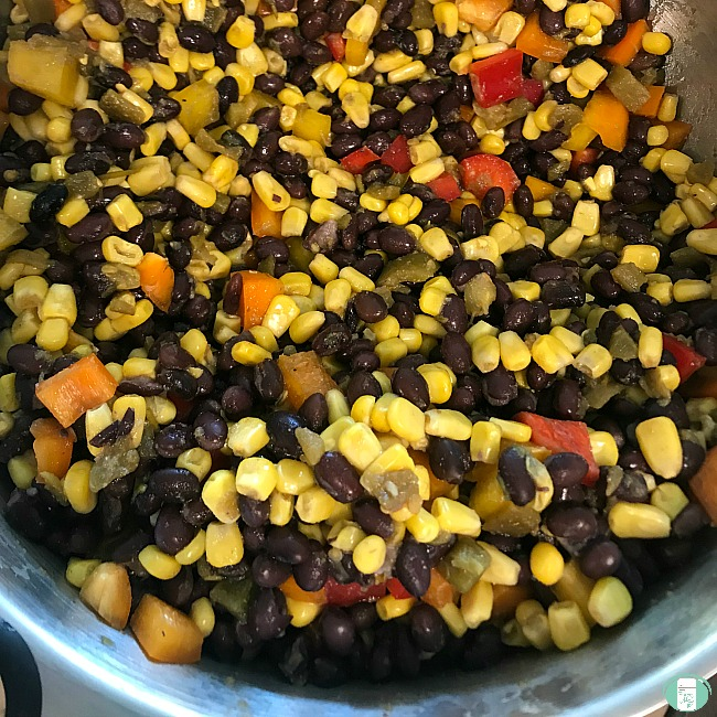 close up of black bean and corn filling to go into the enchiladas