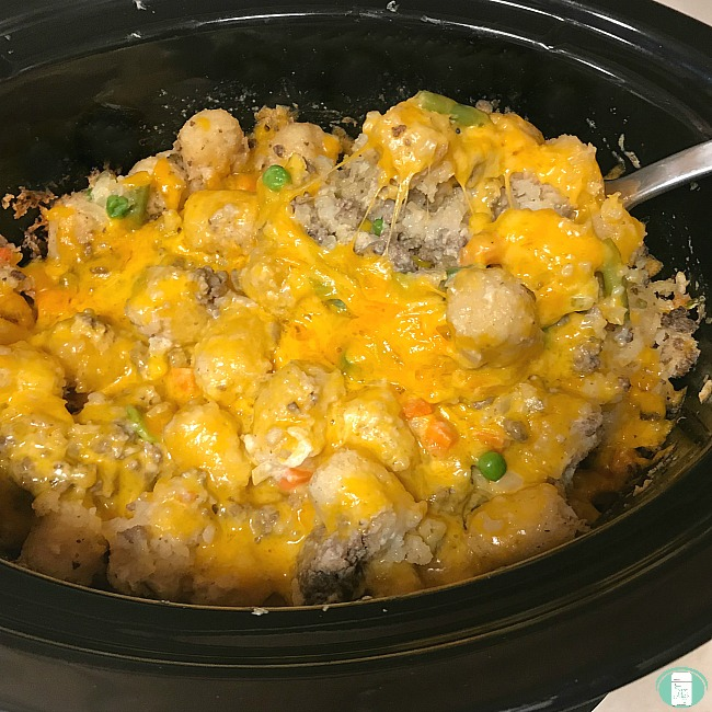 crockpot of tater tot casserole with beef and veggies