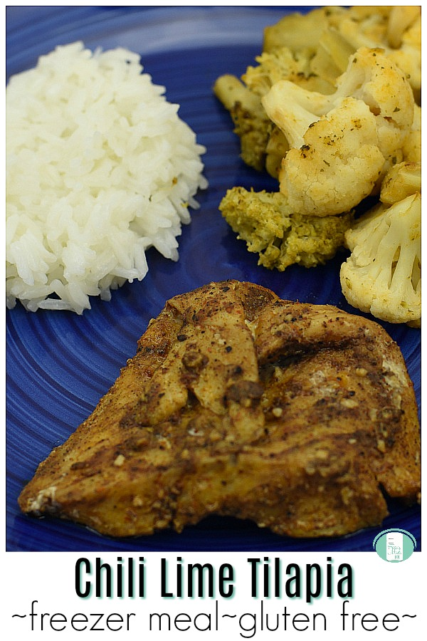 """blue plate with white rice, broccoli, cauliflower, and fish with text that reads """"Chili Lime Tilapia freezer meal gluten free"""" #freezermeals101 #glutenfree #makeahead #chililimetilapia"""