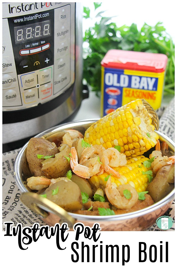 "a pressure cooker and green herbs in the background and a jar of Old Bay seasoning with a bowl of corn, shrimp, and sausage and text reads ""Instant Pot Shrimp Boil"""
