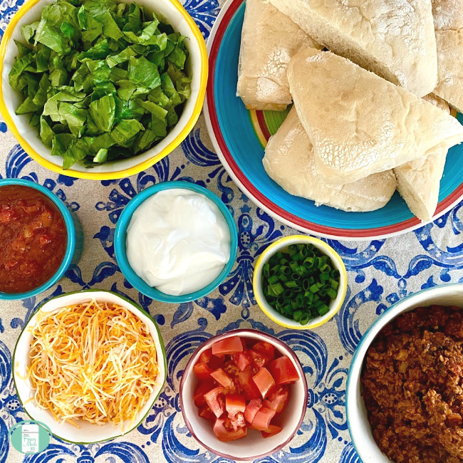 bowls that each contain ingredients to make Taco sloppy Joes
