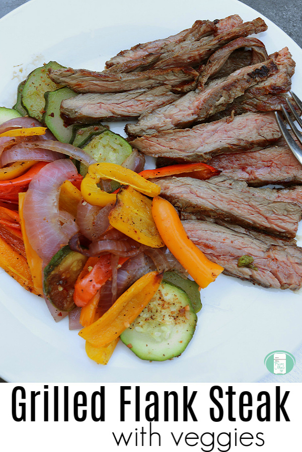 "white plate with sliced meat, yellow peppers, green zucchini, purple onions and text that reads ""Grilled Flank Steak with veggies"" #freezermeals101 #grilledsteak #makeahead #steakandveggies"