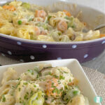 tortellini in a white sauce in a square bowl and oval dish
