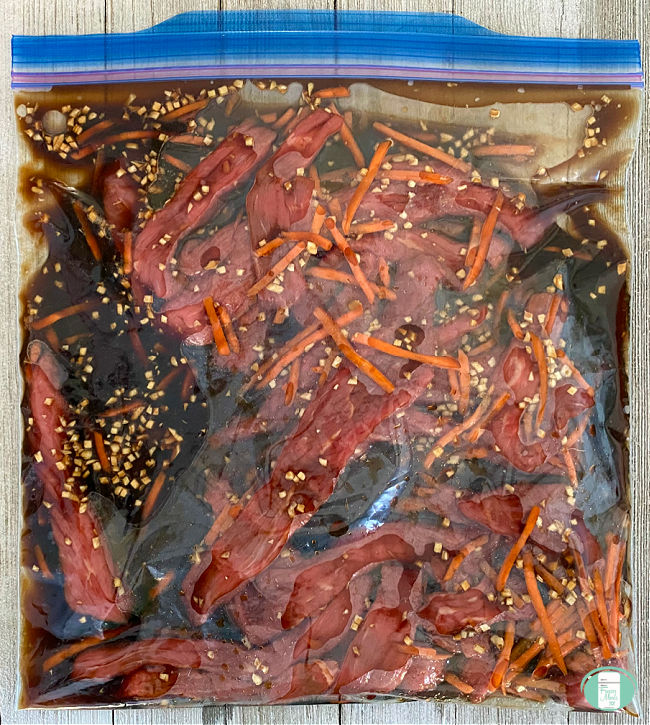 bag full of Mongolian beef strips and sauce