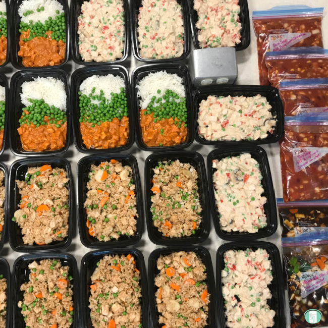 individual dinners in black containers