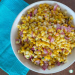 white bowl filled with corn, purple onions