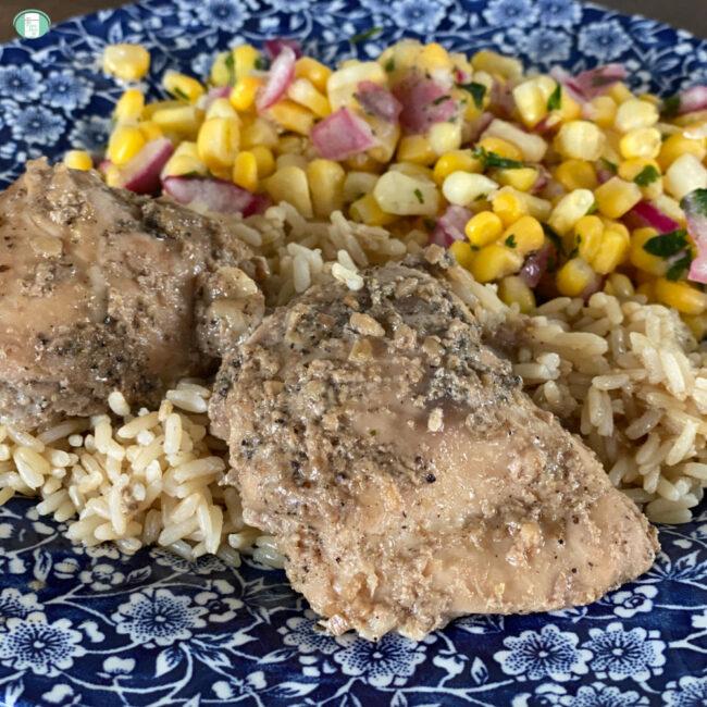 chicken on rice beside corn