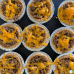 small meat tarts topped with melted cheese