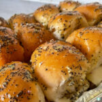 buns covered in poppy seed dressing